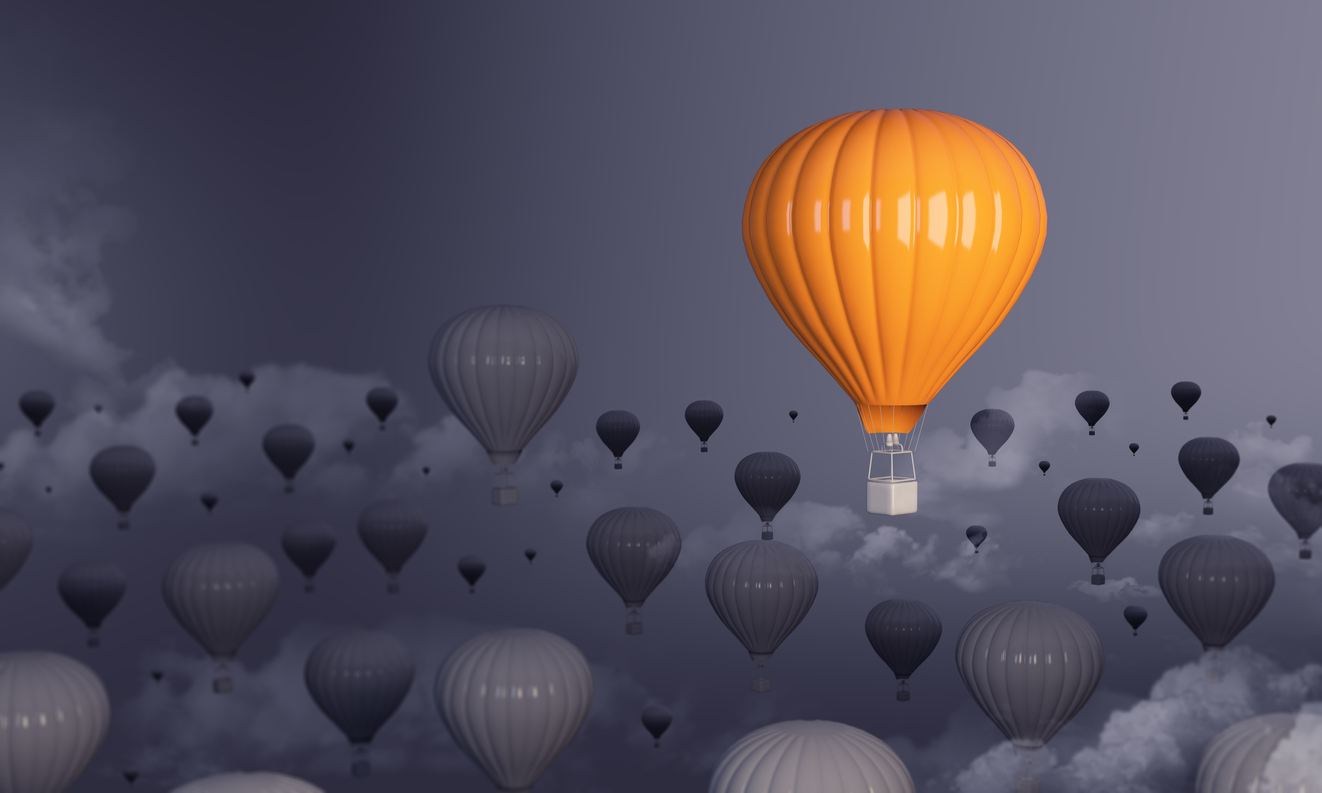 Hot-Air-Balloon-Standing-Out-From-The-Crowd-1041726248_1326x795
